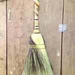 House broom with a double wrap on a twisted handle