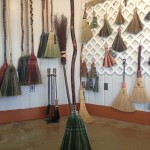 Greens are used in the sweep of this hickory handled kitchen broom