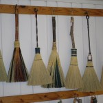A variety of hearth brooms on display