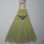 Hearth broom with twisted plait and stitched pattern